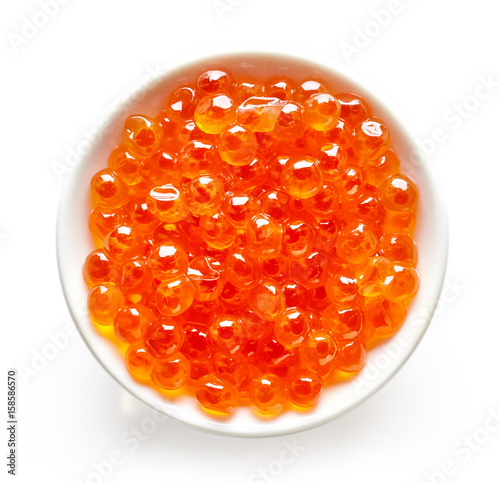 Bowl of red caviar isolated on white, from above