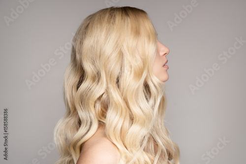 Portrait Of A Beautiful Young Blond Woman With Long Wavy Hair. Fototapet