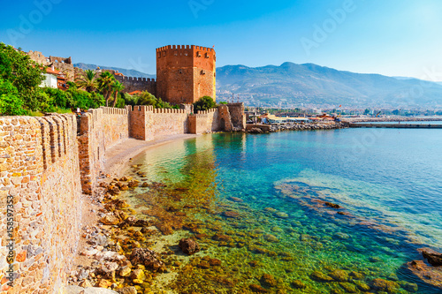 Printed kitchen splashbacks Turkey Kizil Kule tower in Alanya peninsula, Antalya district, Turkey, Asia. Famous tourist destination with high mountains. Part of ancient old Castle. Summer bright day