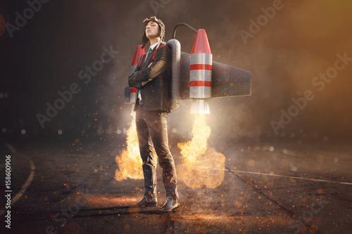Leinwand Poster Geschätsmann mit Jetpack auf dem Rücken