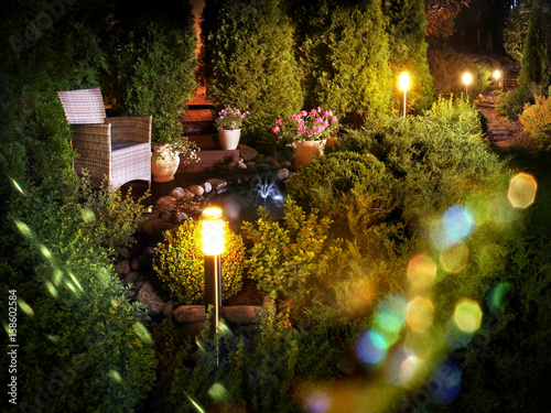 Foto op Canvas Tuin Illuminated home garden fountain patio