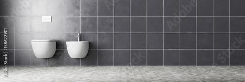 Fotografia  Toilette und Bidet im Badezimmer mit Fliesen