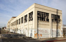 Abandoned Derelict Factory With Blue Sky.