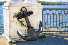 Vintage Rusty Anchor In The Park Near Lake