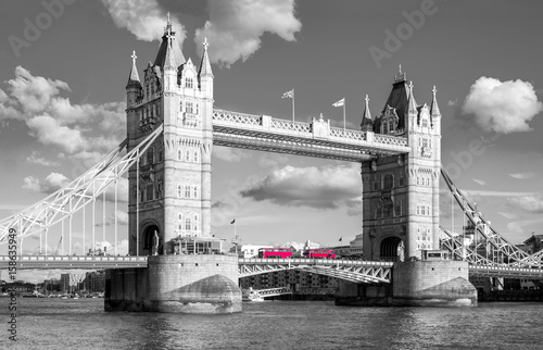 Foto op Canvas Londen rode bus tower bridge with traditional red bus in black and white colors in london