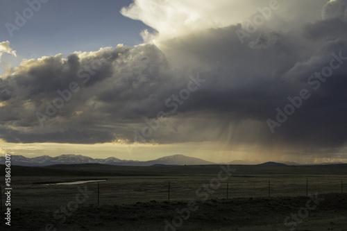 Fotobehang Olijf Stormy mountain meadow