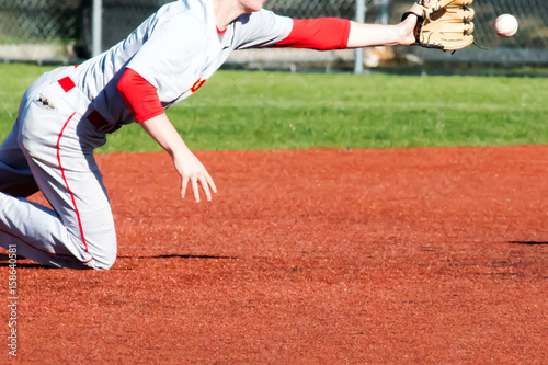Photo  Shortstop diving for the ball