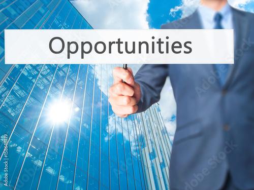Fényképezés  Opportunities - Businessman hand holding sign
