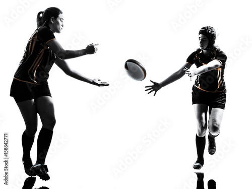 Fototapeta rugby women players team in silhouette isolated on white backround
