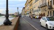 Tourists stroll along the Arno river embankment in Florence