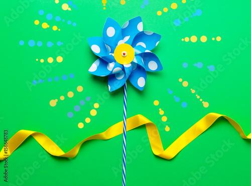 Valokuva  Little pinwheel toy with ribbon
