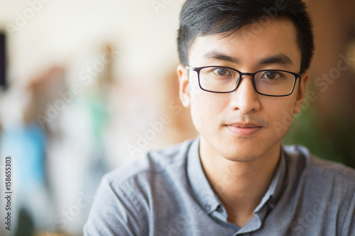 Fotografia  Confident Asian businessman in eyeglasses