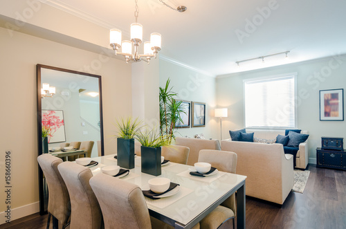 Fotografía  Modern bright dining room with a living room in a luxury apartment