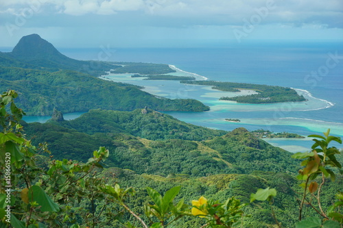 Huahine island landscape from the mountain Pohue Rahi, forest with the lagoon an Fototapet
