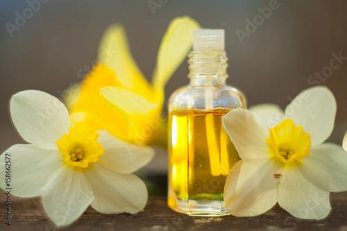 Essence Of Flowers On Table In Beautiful Gl Jar