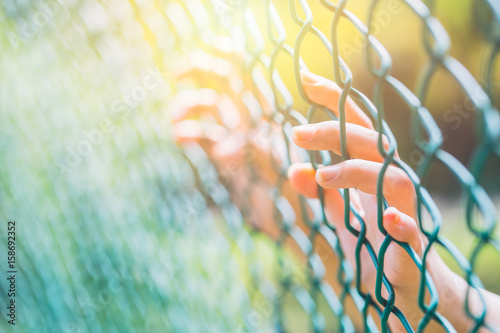 people in jail. hand at the cage. Canvas Print
