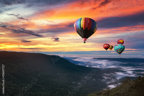 Poster Montgolfière / Dirigeable Hot air balloon over Khao yai national park in morning with beautiful sky, Thailand