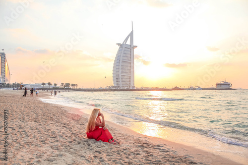 Photo  Woman Sitting On The Beach At Sunset