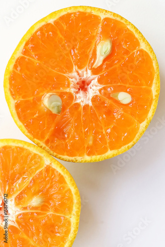 Fotografía  Oranges slice , Slice of fresh oranges against on white background