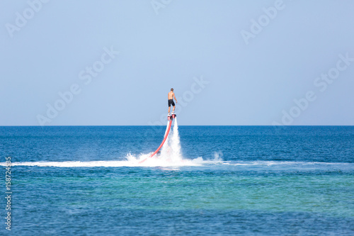 Tuinposter Water Motor sporten Man on a flyboard in the sea