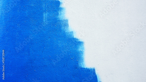 Fotomural  Unfinished blue painted wall background