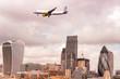Airplane over new London skyline