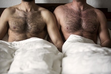 Two Naked Men With Hairy Chest In Bed