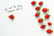 Fresh Strawberries Of Different Shapes On A White Background With Quote Do Not Be Like Everyone Else.Top View. Flat Lay