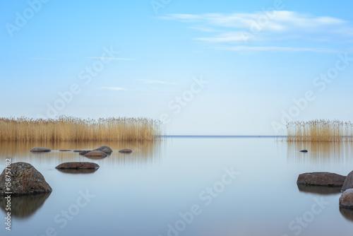 Fotografia, Obraz blue sky is reflected Ladoga lake in the evening