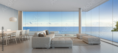 Dining and living room of luxury beach house with sea view ...