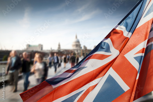 Obraz na plátne union jack flag and people walking on Millennium bridge at St Paul's cathedral -
