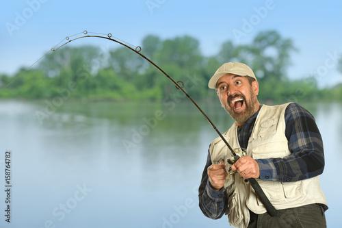 Fotografie, Obraz  Fisherman Catching Fish
