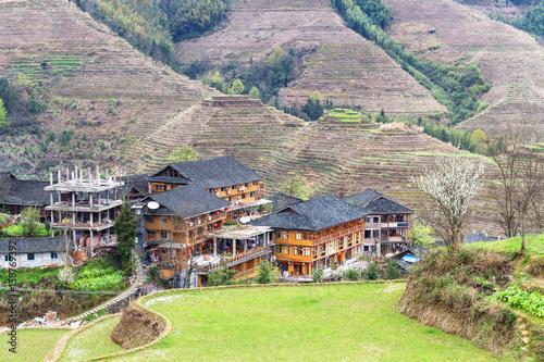 view of houses in village between terraced hills
