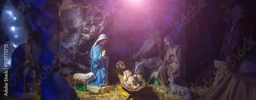 Fotografie, Obraz  Nativity scene with figurines of Jesus, Mary, Joseph, sheep, magi