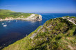 british seaside - summer holiday destination - Lulworth cove on Jurassic coast in southern Devon, UK