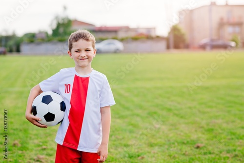 8 years old boy child holding football ball