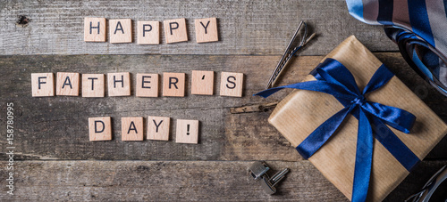 Canvas Prints Countryside Father's day concept - present, tie on rustic wood background