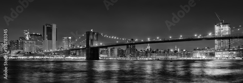 Fototapeta Black and white panoramic photo of Brooklyn Bridge at Night, NYC.