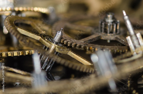 Plakát Watch Parts: Collection of Vintage Metallic Watch Gears on a Black Surface