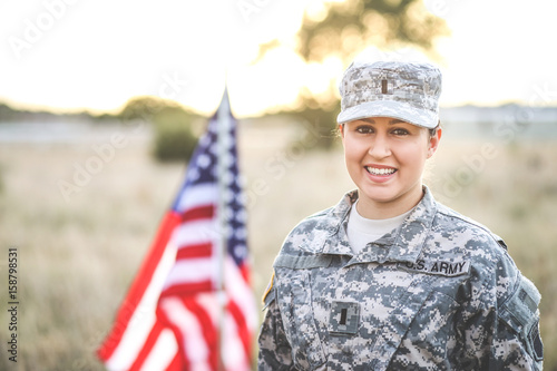 Beautiful Army Woman in Uniform with Flag Canvas Print