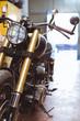 Black motorcycle in repair shop