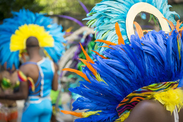 Group of dancers wearing colorful feathers costumes gathered for a gay pride street parade