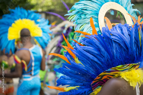 Canvas Prints Carnaval Group of dancers wearing colorful feathers costumes gathered for a gay pride street parade