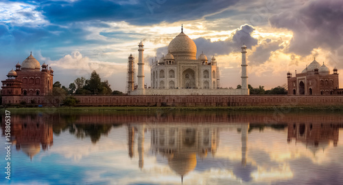 Poster Artistic monument Taj Mahal sunset view from Mehtab Bagh on the banks of Yamuna river. Taj Mahal is a white marble mausoleum designated as a UNESCO World heritage site at Agra, India.