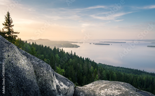 Scenic landscape with lake and sunset at evening in Koli, national park.