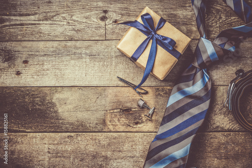Fotografie, Obraz  Father's day concept - present, tie on rustic wood background