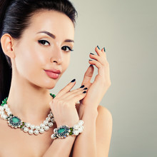 Perfect Glamorous Model Woman With Pearls Necklace And Bracelet. Jewelry Pearls And Green Crystals