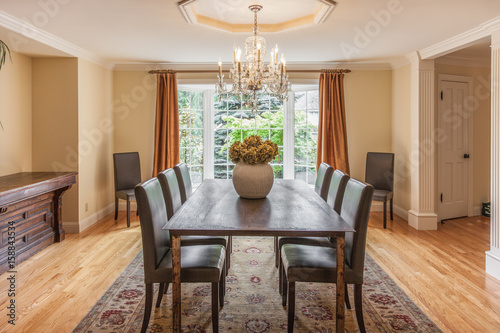 Elegant dining room with wood table and chandelier Poster