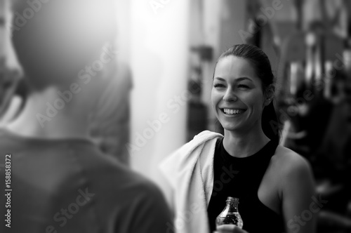 Girl talking to her personal trainer. Black and white image.