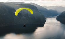 Paraglider Silhouette Flying Over Aurlandfjord, Norway